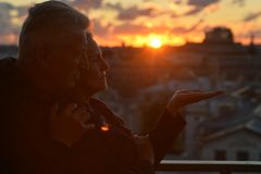Silhouettes of elderly couple Stock Photos