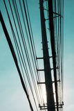 Silhouettes of electric pole Stock Photos