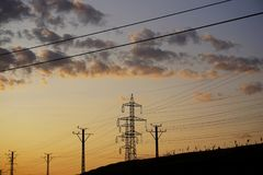 Electricity pylons. Silhouettes of electricity pylons Royalty Free Stock Image