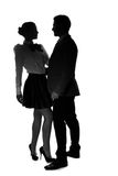 Silhouettes of an elegant romantic couple Royalty Free Stock Images