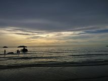 Elephants bathing in the ocean during sunset. Koh Chang island , Thailand. Silhouettes of elephants bathing in the ocean during sunset. Koh Chang island Royalty Free Stock Image