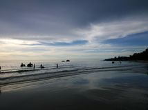 Elephants bathing in the ocean during sunset. Koh Chang island , Thailand. Silhouettes of elephants bathing in the ocean during sunset. Koh Chang island Royalty Free Stock Photo