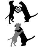 silhouettes för katthundförälskelse Royaltyfri Fotografi