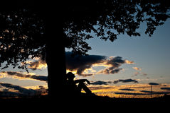 Silhouettes at fall sunset Royalty Free Stock Photo