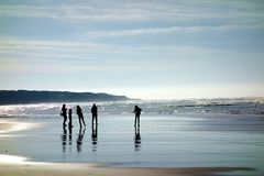 Silhouettes of a Family on the Beach royalty free stock images