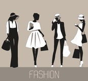 Silhouettes of Fashion women. Royalty Free Stock Photography