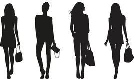 Silhouettes of Fashion women. Royalty Free Stock Photos