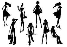 Silhouettes of fashionable girls Stock Image