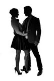 Silhouettes of a fashionable loving couple Stock Photo
