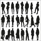 Silhouettes of fashionable men and women Stock Photo