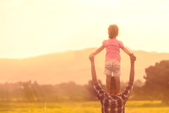 Silhouettes of father and daughter playing together. In the cornfield at sunset stock photography