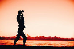 Silhouettes of father and son having fun together Stock Photography