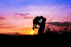 Silhouettes of father and son sunset background Royalty Free Stock Photo