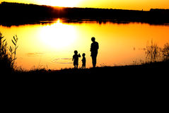 Silhouettes of the father and sons Royalty Free Stock Photo