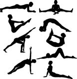 Silhouettes of females in yoga poses Royalty Free Stock Photos