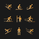 Silhouettes of figures skier icons set. Gold silhouettes of figures skier icons set. Skiing  symbols Royalty Free Stock Image