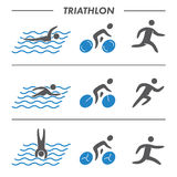 Silhouettes figures triathlon athletes. Swimming, cycling and running  symbols Royalty Free Stock Photography