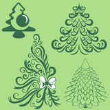 Silhouettes of fir trees. Christmas Trees. Green background Royalty Free Stock Images