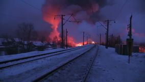 Silhouettes of firefighters in night work. Silhouettes of firefighters in the night work to extinguish the fire in a freight train at the railway station stock footage
