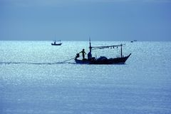 silhouettes fishermen in boat royalty free stock photo