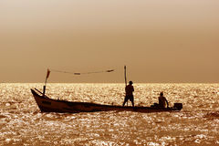 Silhouettes of fishermen Stock Images