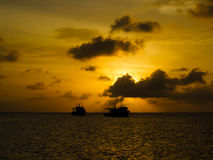 Silhouettes of fishing boats at sunset Caribbean Royalty Free Stock Images