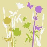 Silhouettes  of flowers and grass Stock Photography