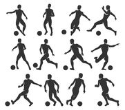 Silhouettes of football players. Soccer players with with ball Royalty Free Stock Photography