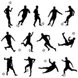 Silhouettes of football players. Vector set of silhouettes of football players Stock Photo