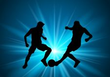 Silhouettes of football or soccer players. On a starburst background Royalty Free Stock Photography