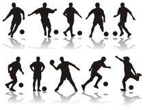silhouettes fotboll Fotografering för Bildbyråer