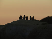 Silhouettes of 5 Friends at Sunset Stock Photos