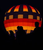 Silhouettes in front of Hot Air Balloon Royalty Free Stock Photography