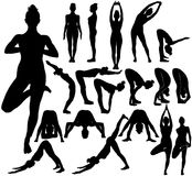 Silhouettes of girl practicing yoga stretching exercises. Silhouettes of slim young girl practicing yoga stretching exercises. Shapes of woman doing yoga Stock Photo