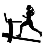 Silhouettes, girl running on the treadmill. Stock Image