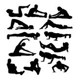 Silhouettes of Girl Stretching And Exercise Stock Photos