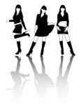 Silhouettes of girls. Silhouettes of young girls in high boots Royalty Free Stock Photo