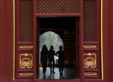 Silhouettes of girls inside Lama Temple. Yonghe Lamasery in Beijing, China Stock Photo