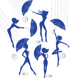 Silhouettes of girls with umbrellas. Vector abstract image of the silhouettes of girls with umbrellas Stock Photo