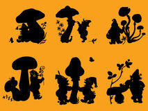 Silhouettes of gnomes and mushrooms. Royalty Free Stock Images