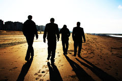 Silhouettes Golden beach. Friends at the gold beach Stock Image