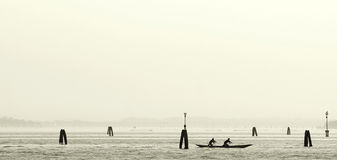 Silhouettes in gondola. In venice Royalty Free Stock Photography