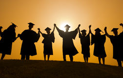 Silhouettes of Graduated Students. At sunset royalty free stock images