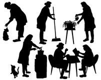 Silhouettes of grandmother taking care of household and relaxing Royalty Free Stock Image