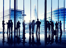 Silhouettes Of Group Of Busy Business People Stock Photography