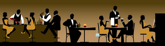 Silhouettes of a group of people holiday makers in a restaurant Royalty Free Stock Image
