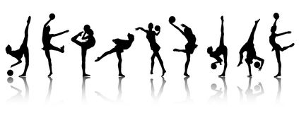 Silhouettes of gymnast girls stock images