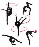 Silhouettes of gymnasts. Gymnasts perform gymnastic elements Royalty Free Stock Photography