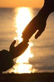 Silhouettes hands of child and  mother Stock Photo