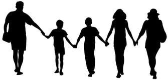 Silhouettes of happy family walking Stock Photo